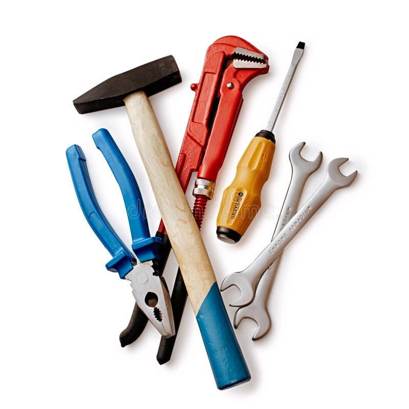 Satz Handarbeits-Werkzeuge lokalisiert auf Weiß stockfotografie