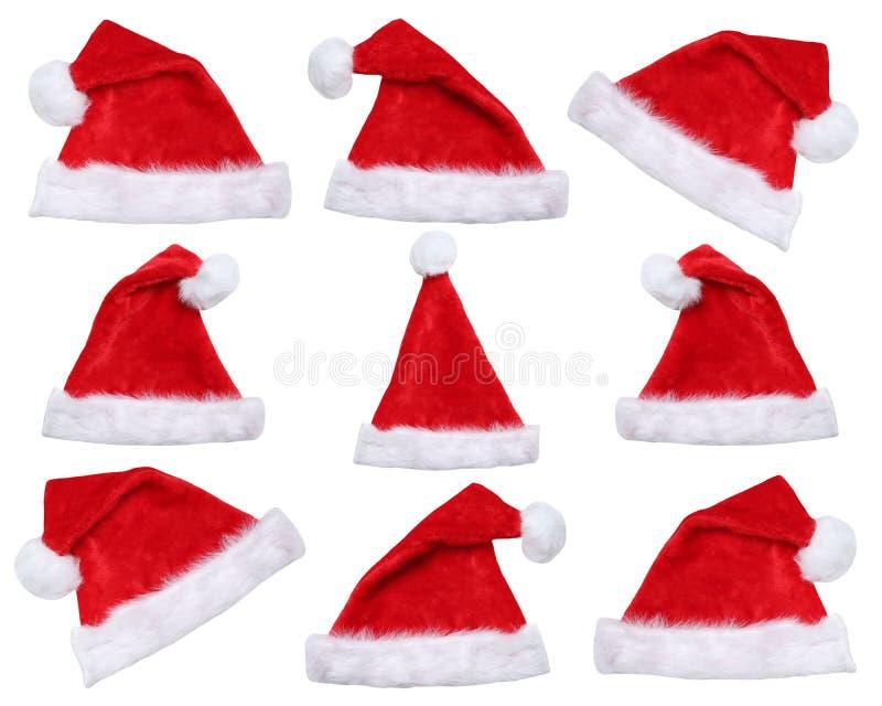 Satz Santa Claus-Hüte auf Weihnachten im Winter lokalisiert stockbild
