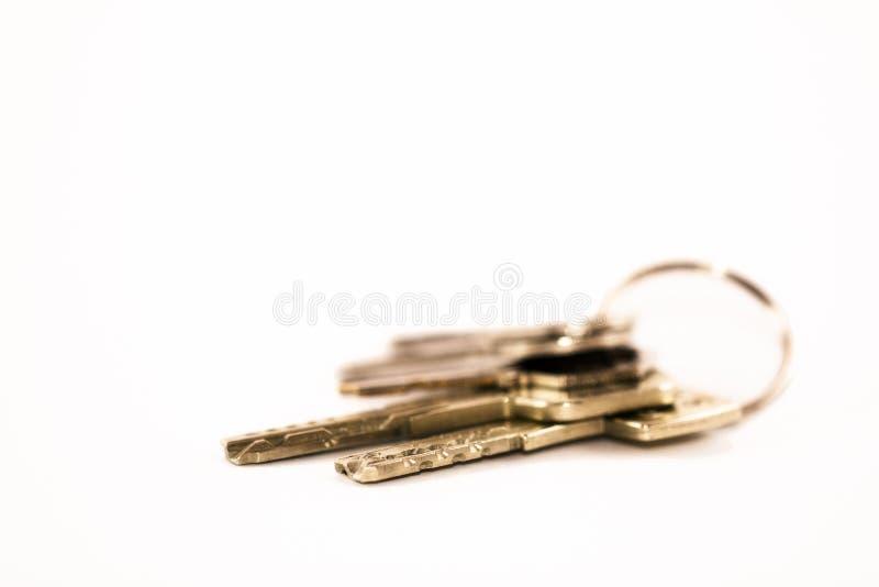 Satz Schlüssel mit weißem Hintergrund lizenzfreies stockfoto