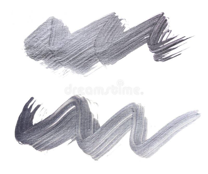 Satz silberne Bürstenanschläge der Acrylfarbe als Probe des Kunstproduktes lizenzfreie abbildung