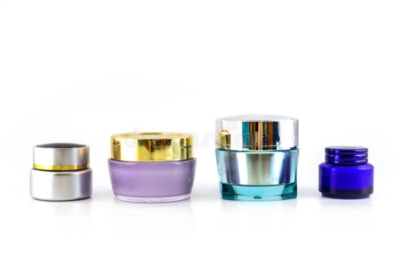 Satz unterschiedliche Kosmetikcreme stockbild