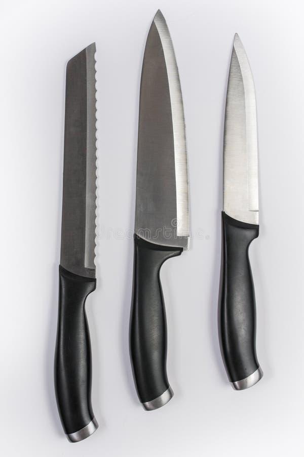 Satz von drei Küchen-Messern auf weißem Hintergrund lizenzfreies stockbild