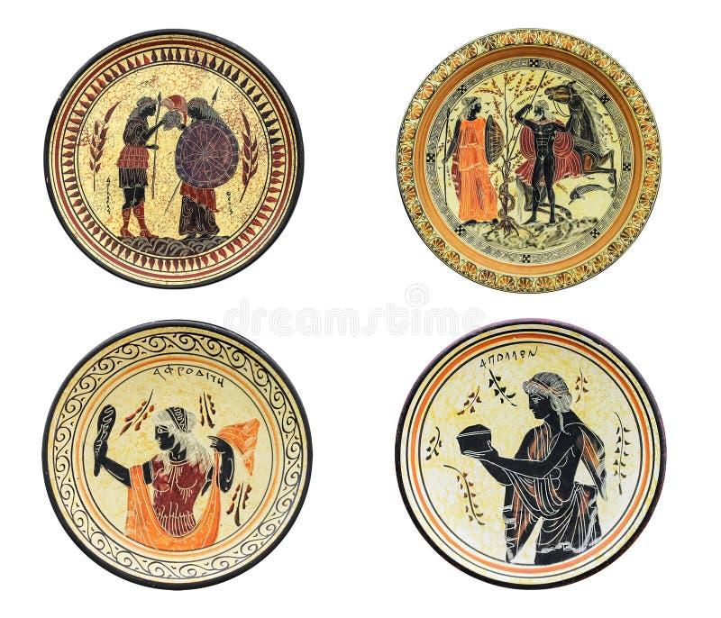 Satz von vier altgriechischen Tellern lokalisiert auf weißem Hintergrund lizenzfreie stockfotos