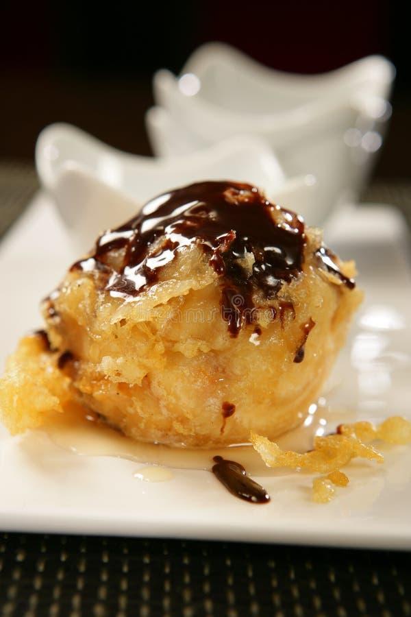 sauce à poire cuite à la friteuse par chocolat images libres de droits