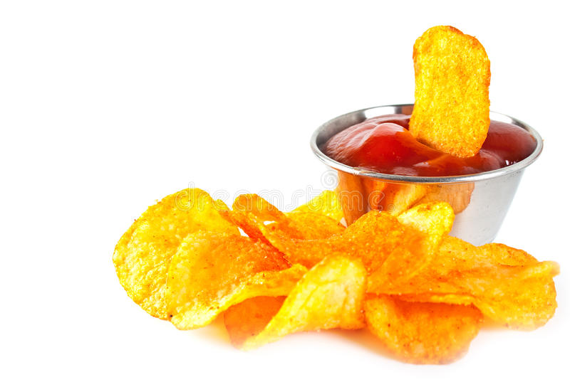 Sauce boat. Silver sauce-boat and fried potato chips on a white background stock images