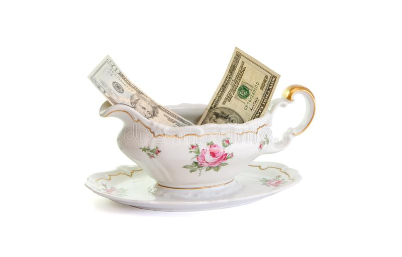Sauce-boat da porcelana do vintage com contas de dólar fotos de stock