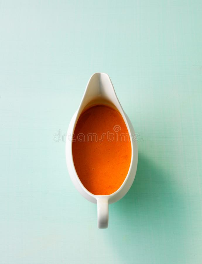 Sauce boat with tomato sauce isolated. With copy space stock photo