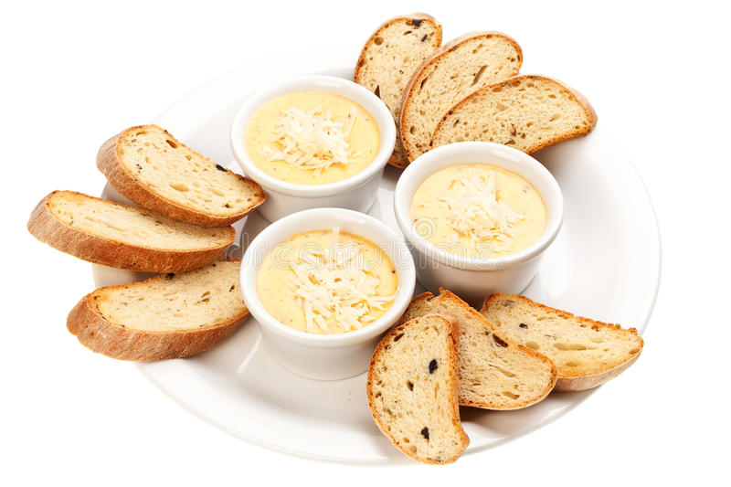 Sauce with cheese and bread royalty free stock images