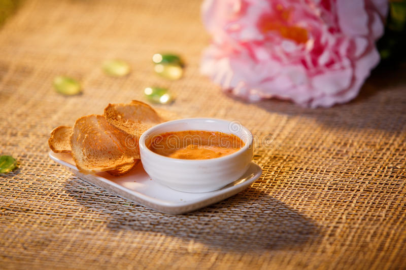 Sauce with croutons in a white cup royalty free stock photos