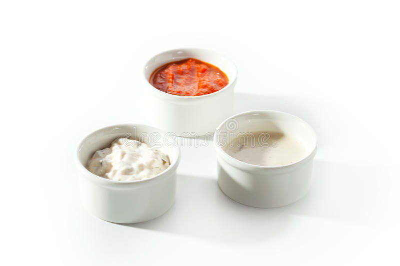 Sauces. Bowl over White Background royalty free stock photos