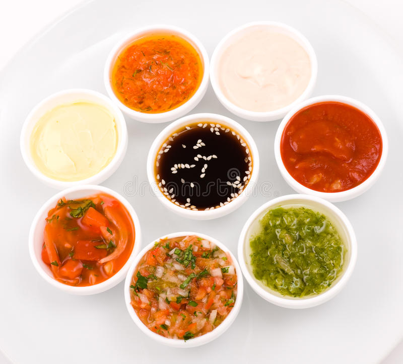 Sauces palette. Eastern cuisine - several sauceboats with different sauces and seasonings stock image