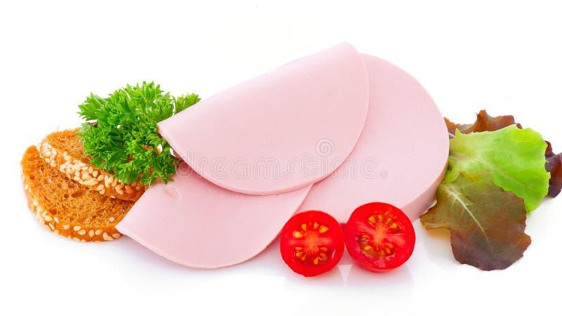 Saucisse bouillie coupée en tranches photographie stock