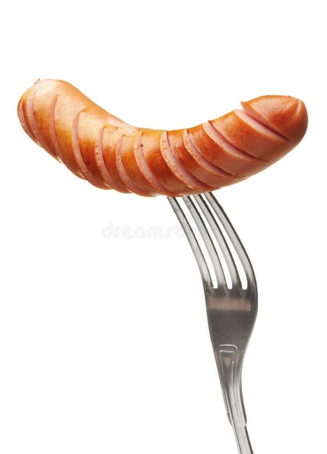 Saucisse grillée sur une fourchette photos stock