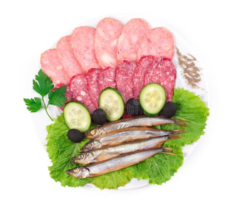 Saucisses avec des poissons de hareng image stock