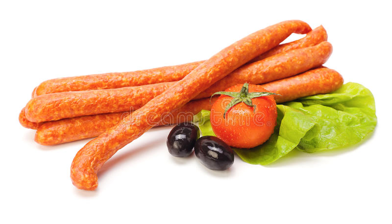Saucisses et légumes images libres de droits