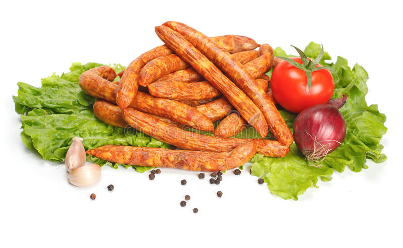 Saucisses minces avec des légumes photo libre de droits