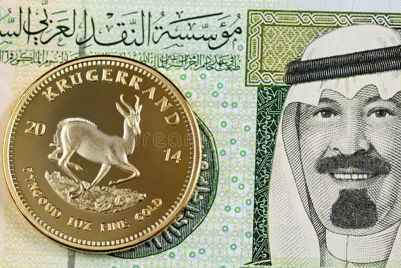 Saudí un billete de banco del Riyal con un oro Krugerrand fotos de archivo libres de regalías