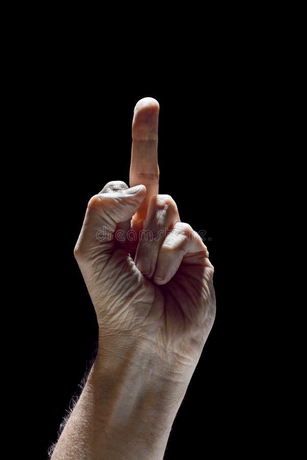 Saudação do dedo no fundo preto fotos de stock