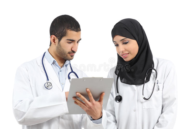 Saudi arab doctors diagnosing looking a medical history. Isolated on a white background stock photography