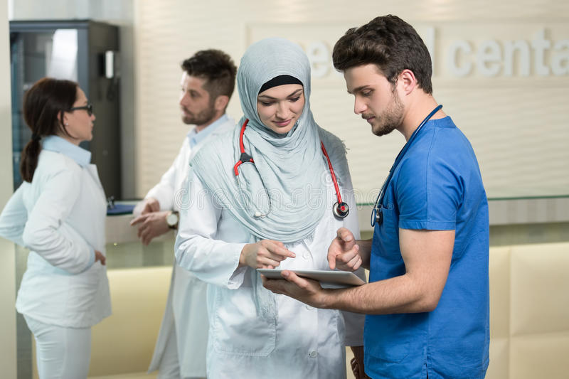 Saudi arab doctors working with a tablet. royalty free stock photography