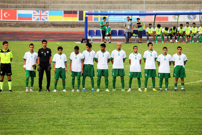 Saudi arabia anthem. The football deaf saudi arabia tema during the national anthem before the world cup match vs argentina played at eboli in italy stock image
