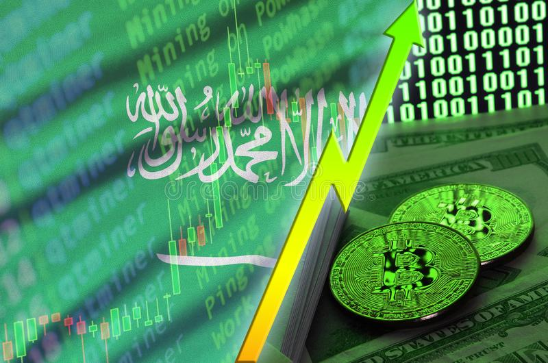Saudi Arabia flag and cryptocurrency growing trend with two bitcoins on dollar bills and binary code display royalty free stock photo