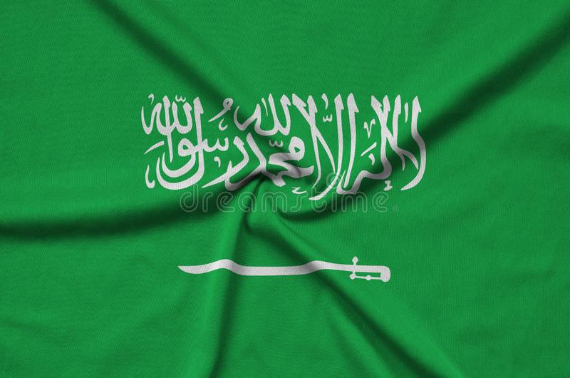 Saudi Arabia flag is depicted on a sports cloth fabric with many folds. Sport team banner royalty free stock images