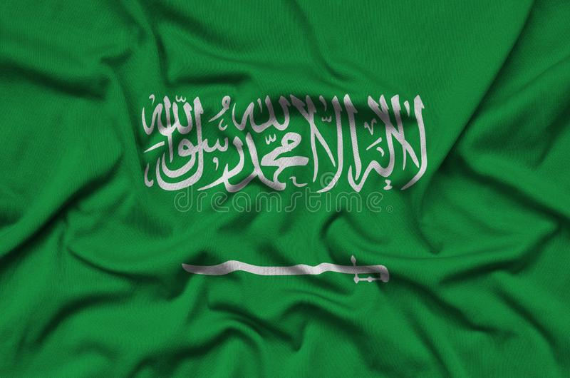 Saudi Arabia flag is depicted on a sports cloth fabric with many folds. Sport team banner stock photos