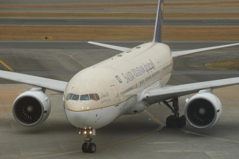 Saudi Arabian B777. Saudi Arabian Airlines is the flag carrier airline of Saudi Arabia, based in Jeddah and currently the third largest of the region, behind stock image