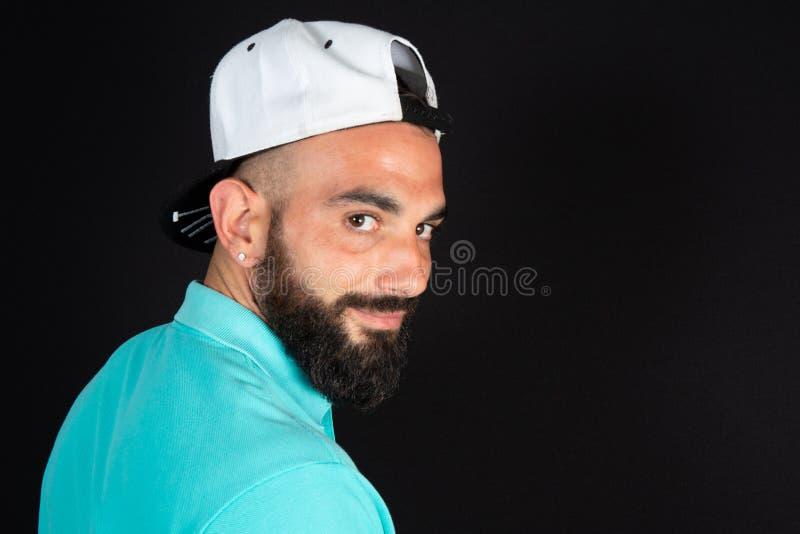 Saudi Arabian Muslim guy portrait on black background royalty free stock photos