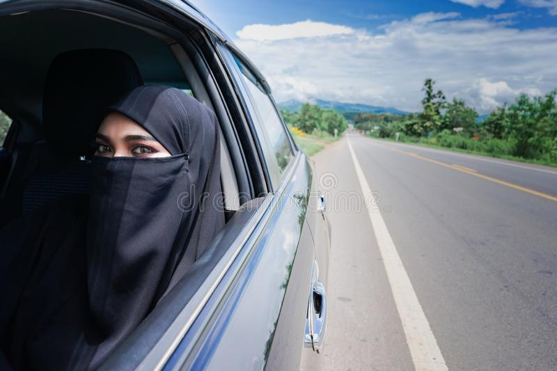 Saudi Woman Driving a Car on the road. Muslim Woman Driver concept stock photos