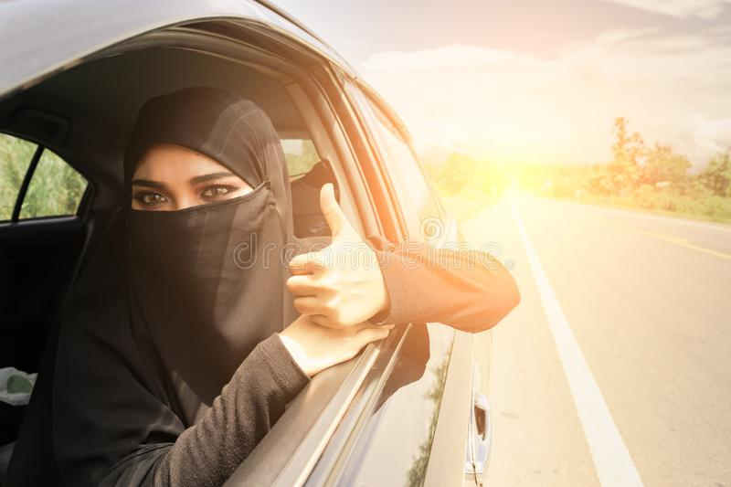 Saudi Woman Driving a Car on the road. Muslim Woman Driver concept stock image