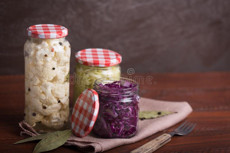 Sauerkraut in a blue bowl on a wooden table. Copy space. Sauerkraut is fermented cabbage. Typical fermented food in some countries such as Russia. Poland or stock photo