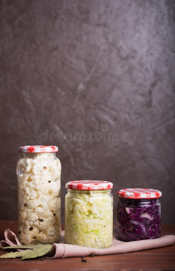 Sauerkraut in a blue bowl on a wooden table. Sauerkraut is fermented cabbage. Typical fermented food in some countries such as Russia. Poland or German. It is royalty free stock image
