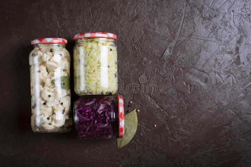 Sauerkraut in a blue bowl on a wooden table. Top view. Sauerkraut is fermented cabbage. Typical fermented food in some countries such as Russia. Poland or German stock image