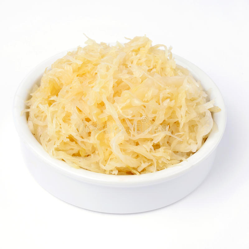 Sauerkraut. Delicious sauerkraut closeup on plate isolated over white royalty free stock images