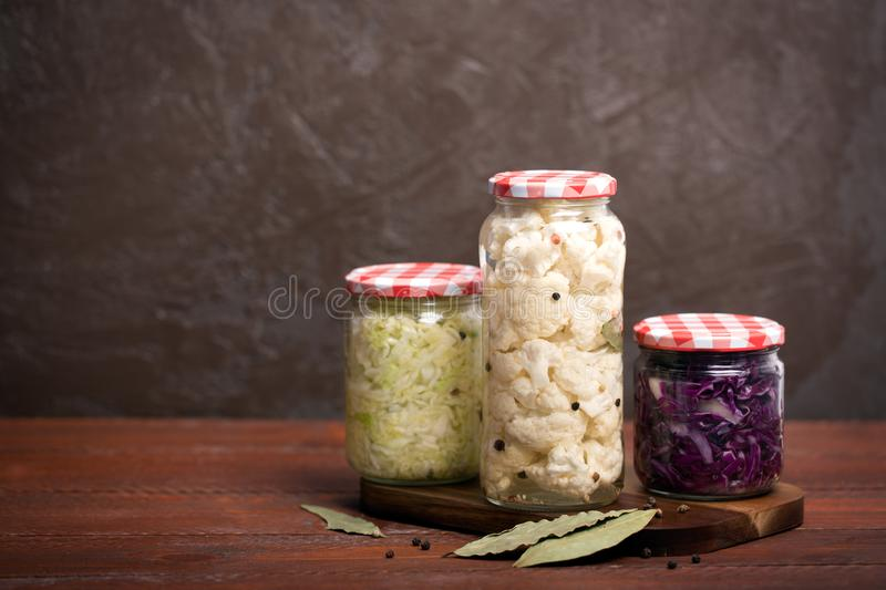 Sauerkraut in a blue bowl on a wooden table. Sauerkraut is fermented cabbage. Typical fermented food in some countries such as Russia. Poland or German. It is royalty free stock photos