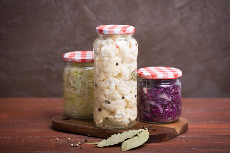 Sauerkraut in a blue bowl on a wooden table. Sauerkraut is fermented cabbage. Typical fermented food in some countries such as Russia. Poland or German. It is royalty free stock photo