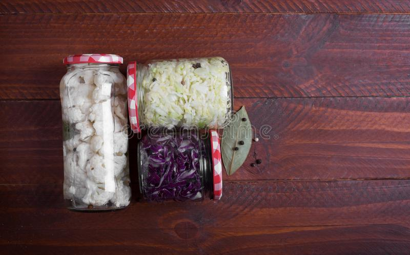 Sauerkraut in a blue bowl on a wooden table. Top view. Sauerkraut is fermented cabbage. Typical fermented food in some countries such as Russia. Poland or German royalty free stock photo