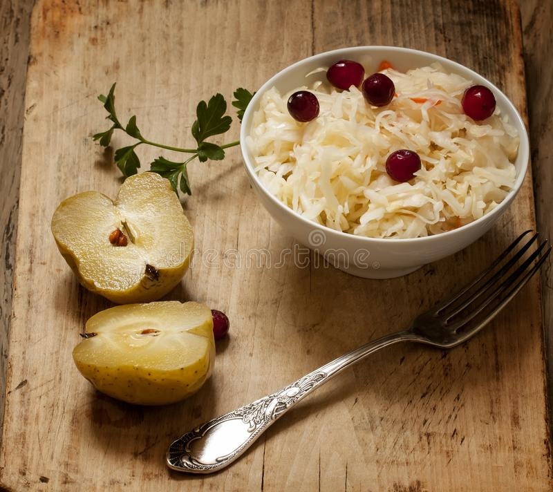 Sauerkraut and pickled apples food still life. Russian sauerkraut and pickled apples food still life selective focus royalty free stock image