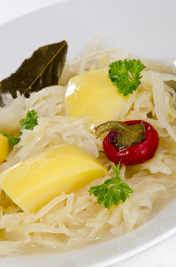 Sauerkraut soup with boiled potatoes stock image
