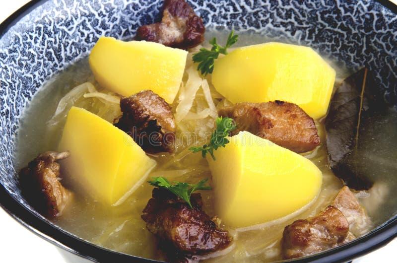 Sauerkraut soup with potatoes stock photos