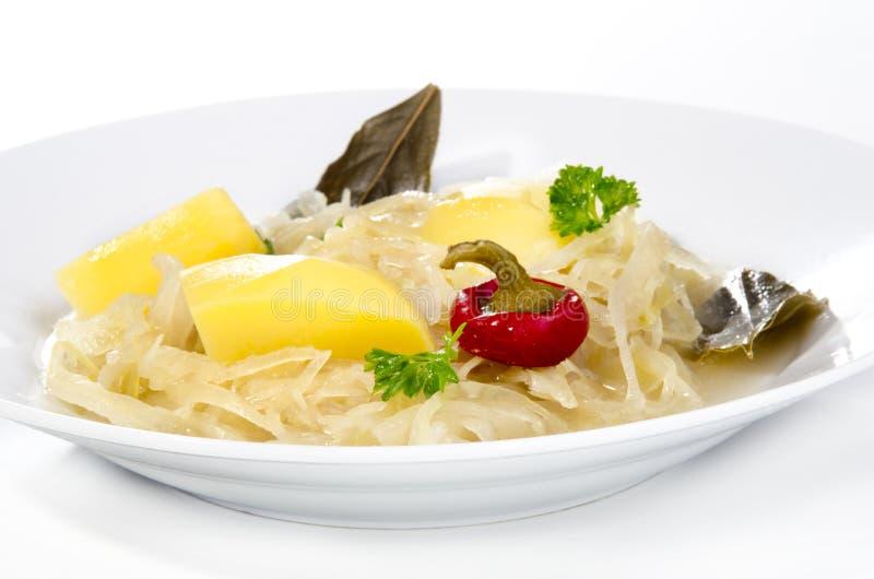 Sauerkraut soup with potatoes royalty free stock photo