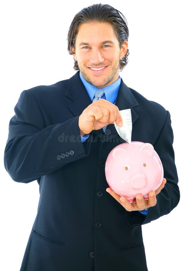 Sauf l'argent sur la tirelire photos stock