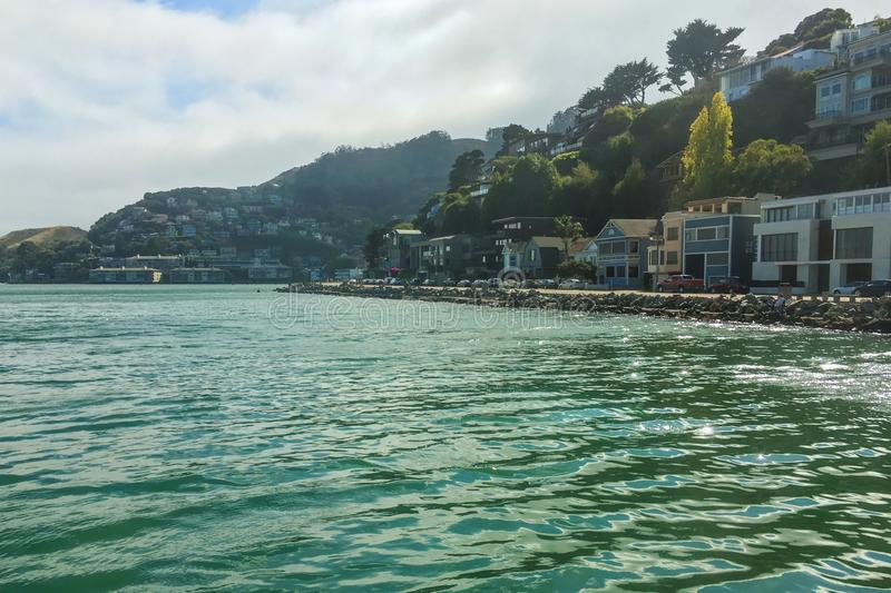 Sausalito coast bay front houses hill expensive trees. Sausalito, United States - September 08, 2016 : The beautiful big mansions near the coastline of this stock images