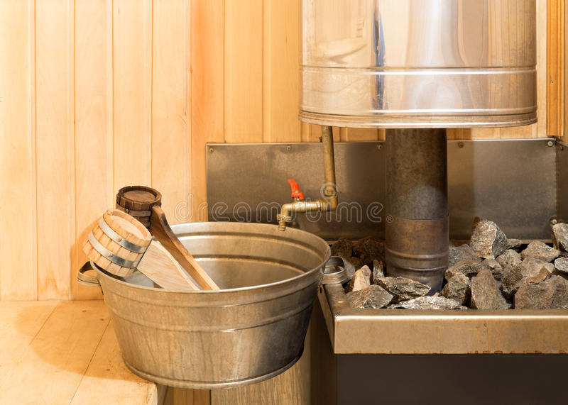 Sauna accessories in steam room royalty free stock photo