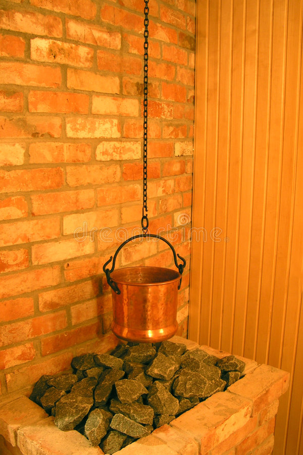 Sauna with caldron on coals. In hotel royalty free stock photo