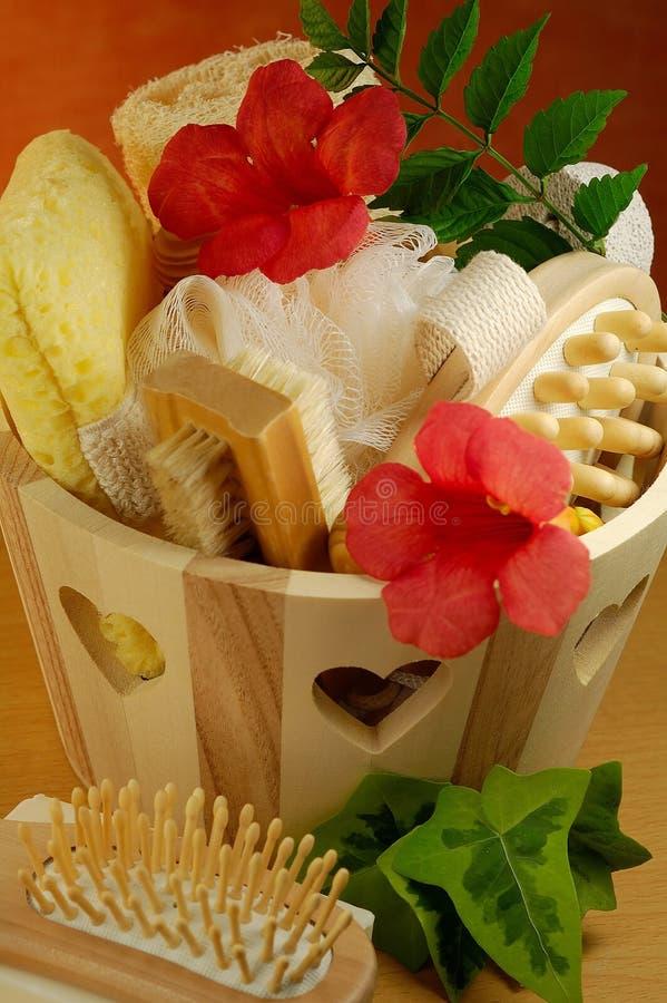 Sauna items. Sauna and bath accessories with fresh flowers royalty free stock photo