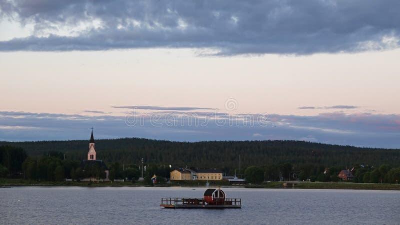Sauna raft on summer evening at Lake Hornavan and Arjeplog in Lapland, Sweden stock image