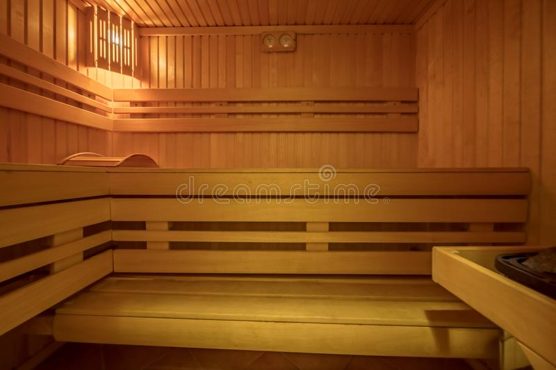 Sauna room interior. Finnish heat bath made of natural wood royalty free stock images